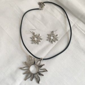"""Silver tone """"Sun"""" necklace and earrings."""